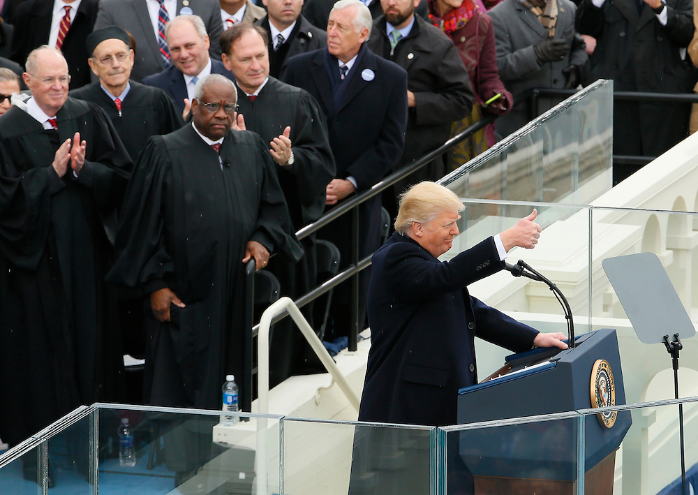 U.S. President Donald Trump gives a thumps-up as members of the Supreme Court (L-R) Anthony Kennedy, Stephen Bryer, Clarence Thomas and Samuel Alito look on at the inauguration ceremonies on the West front of the U.S. Capitol in Washington, U.S., January 20, 2017. REUTERS/Rick Wilking  - RTSWJBD