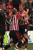 Photo: Tony Oudot.<br /> <br /> Brentford v Lincoln City. Coca Cola League 2. 27/10/2007.<br /> <br /> Sammy Moore of Brentford celebrates his winning goal with team mate Craig Pead