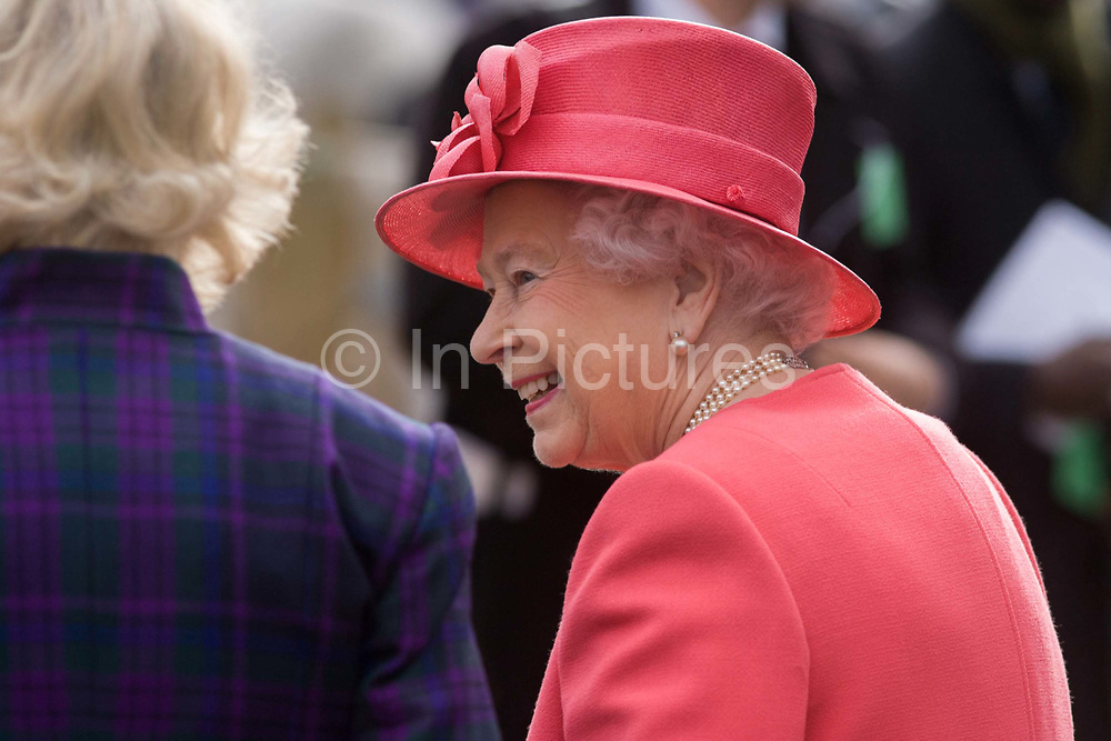 Queen Elizabeth makes a brief visit to the Ebony Horse Club at Loughborough Junction, Brixton, London. Accompanied by the Duchess of Cornwall, Her Majesty watched an equestrian demonstration in one of the most disadvantaged inner city neighbourhoods in the country where there is a historic legacy of under-achievement in schools, high rates of teenage pregnancy and negative stereotypes of young people, gang violence and drug related crime.