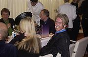 Philip Treacy. I.D. magazine dinner for John Dempsey of Mac cosmetics, Fifth floor restaurant, Harvey Nichols. 17 December 2002. © Copyright Photograph by Dafydd Jones 66 Stockwell Park Rd. London SW9 0DA Tel 020 7733 0108 www.dafjones.com