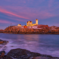 Cape Neddick Lighthouse with Holidays Decoration taken at sunset in York, Maine. Loved watching this sunset burst into colors and capturing the Christmas Lights while the last light of the day created a beautiful sky across one of Maine's most iconic Christmas light scenes.<br />