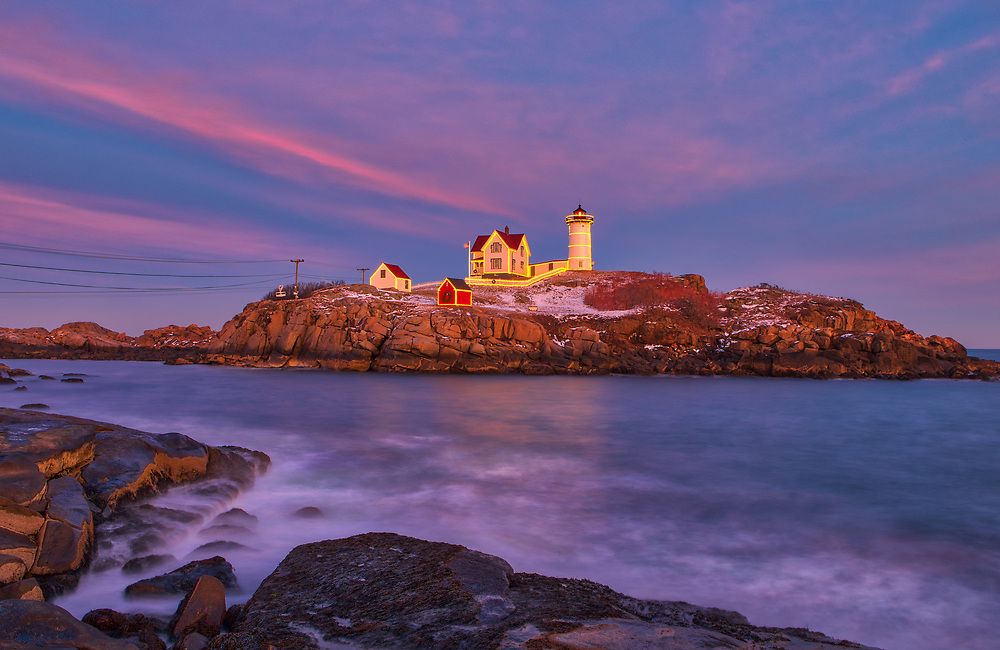 Cape Neddick Lighthouse with Holidays Decoration taken at sunset in York, Maine. Loved watching this sunset burst into colors and capturing the Christmas Lights while the last light of the day created a beautiful sky across one of Maine's most iconic Christmas light scenes.<br /> <br /> Maine Cape Neddick Lighthouse fine art photography is available as museum quality photography prints, canvas prints, acrylic prints or metal prints. Prints may be framed and matted to the individual liking and room decor needs:<br /> <br /> https://juergen-roth.pixels.com/featured/nubble-lighthouse-with-christmas-decoration-juergen-roth.html<br /> <br /> My best,<br /> <br /> Juergen<br /> Prints: http://www.rothgalleries.com<br /> Photo Blog: http://whereintheworldisjuergen.blogspot.com<br /> Instagram: https://www.instagram.com/rothgalleries<br /> Twitter: https://twitter.com/naturefineart<br /> Facebook: https://www.facebook.com/naturefineart