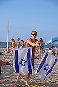 pois with the Israeli flag at drummers beach Tel Aviv, Israel