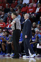 20 January 2017:  Paul Janssen walks the sideline and counts time near Greg Lansing during an NCAA Missouri Valley Conference mens basketball game Where the Purple Aces of Evansville lost to the Illinois State Redbirds 75-73 in Redbird Arena, Normal IL