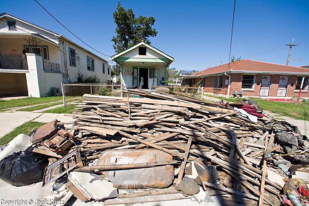 20 SEPTEMBER 2006 - NEW ORLEANS, LOUISIANA: Garbage in front of a home in the Lower 9th Ward of New Orleans, LA. The neighborhood was abandoned after flooding from nearby canals after Hurricane Katrina inundated this part of the city. Photo by Jack Kurtz / ZUMA Press