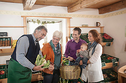 Family buying vegetables in the farm, Bavaria, Germany