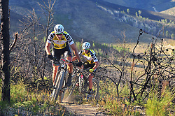 WELLINGTON SOUTH AFRICA - MARCH 23: Yellow Jersey wearers Jaroslav Kulhavy and Howard Grotts during stage five's 39km time trial on March 23, 2018 in Wellington, South Africa. Mountain bikers gather from around the world to compete in the 2018 ABSA Cape Epic, racing 8 days and 658km across the Western Cape with an accumulated 13 530m of climbing ascent, often referred to as the 'untamed race' the Cape Epic is said to be the toughest mountain bike event in the world. (Photo by Dino Lloyd)
