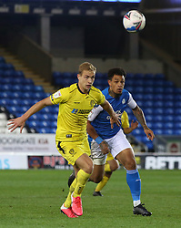 Jonson Clarke-Harris of Peterborough United in action against Sam Hughes of Burton Albion - Mandatory by-line: Joe Dent/JMP - 27/10/2020 - FOOTBALL - Weston Homes Stadium - Peterborough, England - Peterborough United v Burton Albion - Sky Bet League One