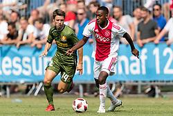 (L-R) Mathias Rasmussen of FC Nordsjælland, Navajo Bakboord of Ajax during the friendly match between Ajax Amsterdam and FC Nordsjaelland  on July 7, 2018 at Sportpark Putter Eng in Putten, The Netherlands