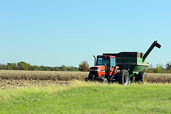 20 October 2007: a tractor pulling a grain wagon sits idle at the edge of a corn field being harvested