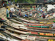 22 OCTOBER 2015 - YANGON, MYANMAR:  Small boats used as ferries on the Yangon River in Yangon.     PHOTO BY JACK KURTZ