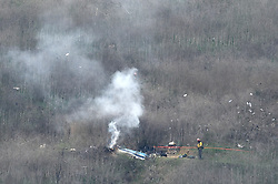 Kobe Bryant's helicopter is seen smoldering at the crash site in Calabasas California on Sunday morning. Kobe and his 13-year-old daughter were on board. They were set to attend a basketball clinic together. Fans and neighbors can be seen gathering in shock outside the crash zone. 26 Jan 2020 Pictured: Kobe Bryant's helicopter is seen smoldering at the crash site in Calabasas California. Photo credit: Garrett Alan Cheen / MEGA TheMegaAgency.com +1 888 505 6342