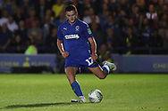 AFC Wimbledon defender Tyler Garratt (12) passing the ball during the EFL Carabao Cup 2nd round match between AFC Wimbledon and West Ham United at the Cherry Red Records Stadium, Kingston, England on 28 August 2018.