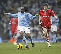 Photo: Aidan Ellis.<br /> Manchester City v Charlton Athletic. The Barclays Premiership. 12/02/2006.<br /> City's Kiki Musampa ngets away from Charlton's Alexi Smertin