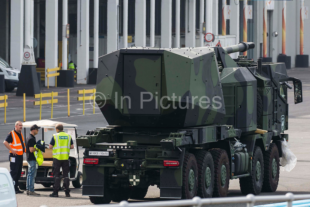 An armed military vehicle is pictured in a holding area outside ExCeL London as preparations for the DSEI 2021 arms fair take place on 6th September 2021 in London, United Kingdom. The first day of week-long Stop The Arms Fair protests outside the venue for one of the worlds largest arms fairs was hosted by activists calling for a ban on UK arms exports to Israel.