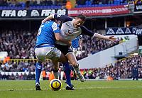 Photo: Daniel Hambury.<br />Tottenham Hotspur v Birmingham City. The Barclays Premiership. 26/12/2005.<br />Tottenham's Robbie Keane (R) is fouled by Birmingham's Matthew Upson for a penalty.