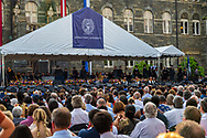Washington, DC , USA -- May 19, 2019. A large audience of parents, friends and relatives watches as new graduates of Georgetown University file in at