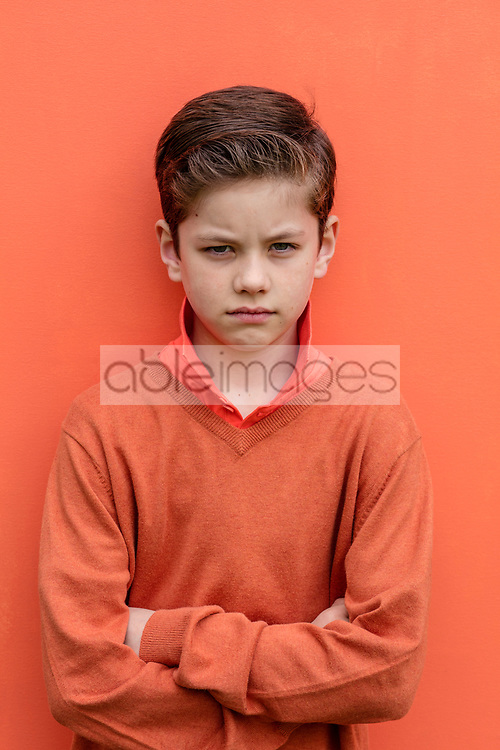 Portrait of Young Boy with Arms Crossed