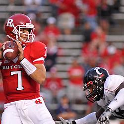 Sep 7, 2009; Piscataway, NJ, USA; Rutgers quarterback Tom Savage (7) avoids the pressure by Cincinnati defensive tackle Brandon Mills (58) during the second half as Cincinnati defeats Rutgers 47-15 in NCAA Big East football at Rutgers Stadium.