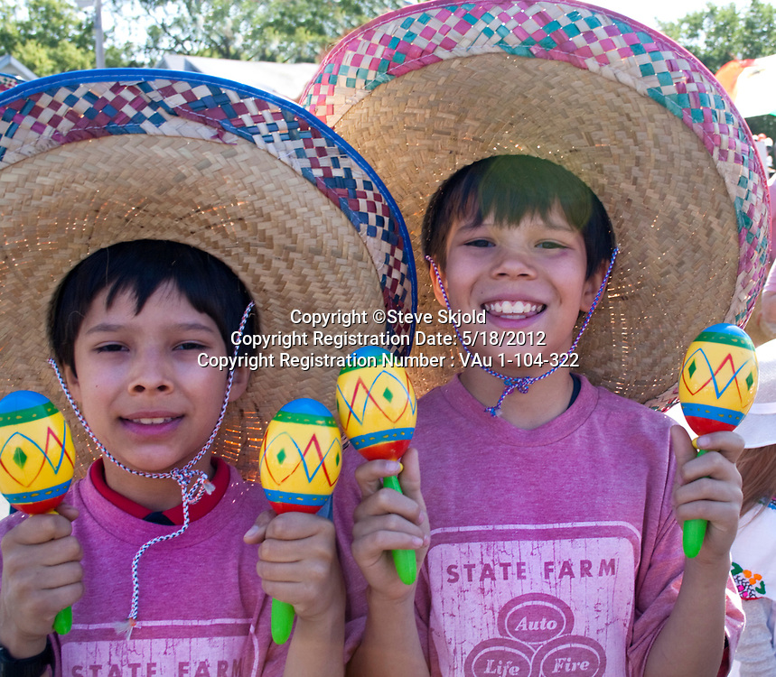 Mexican American boys wearing sombreros playing maracas in the parade. Mexican Independence Day Minneapolis Minnesota MN USA