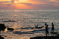 At sunset, a man dives into the Mediterranean Sea in Beirut, Lebanon