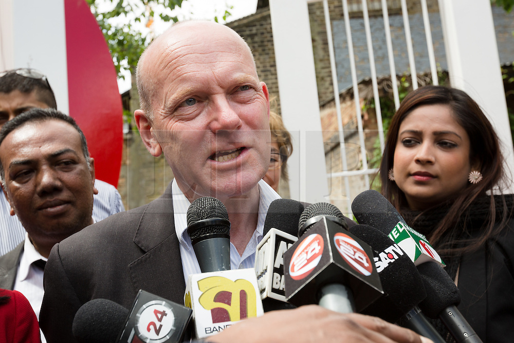 © Licensed to London News Pictures. 06/06/2015. London, UK. John Biggs speaking to the Bengali media at a Labour Party rally for Tower Hamlets Mayoral candidate, John Biggs in Altab Ali Park in Tower Hamlets, east London. The three women Bangladeshi London Labour MPs (Rushanara Ali, Tulip Siddiq and Rupa Huq) attended the rally today with Labour Party supporters. Photo credit : Vickie Flores/LNP