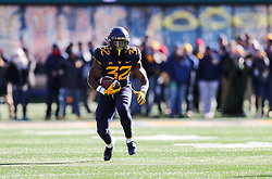 Nov 10, 2018; Morgantown, WV, USA; West Virginia Mountaineers running back Martell Pettaway (32) runs the ball during the second quarter against the TCU Horned Frogs at Mountaineer Field at Milan Puskar Stadium. Mandatory Credit: Ben Queen-USA TODAY Sports