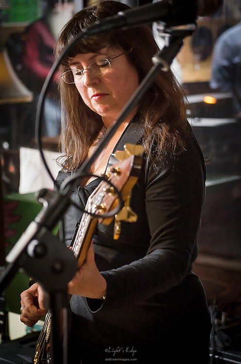 Sue Pepiak of Lost Art, on bass, perfoming at The Bus Stop Music Cafe in Pitman, NJ.