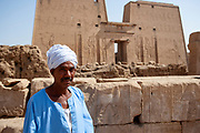 Egyptian guide wearing traditional turban in front of the Edfu Temple