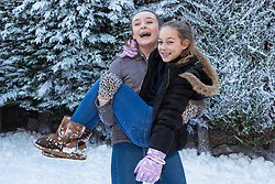 Tunbridge Wells, December 16 2017. Winner of the TK Maxx White Christmas promotion enjoy a day of fun in the snow, after aunt Helen Haggertay found one of the 'snow globes' in TK Maxx in Tunbridge Wells and gifted it to her sister Louise and niece Sofia Migliaccio. An exciting day ensued after several tons of snow were delivered BY TK Maxx and friends arrived to enjoy the day. PICTURED:  L-R Lily, 13, and Sofia, 9: