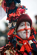 A performer from The Lions Part company dressed as St George takes part in an annual traditional free theatre celebrating a 'wassail' celebration to herald the new year. Bankside , London, UK. To celebrate the New Year, actors (The Bankside Mummers) associated with the Lion's Part company from the Globe Theatre, perform in traditional costume and entertain the crowds by the Thames. Participants dressed as St George and the Holly Man in the winter guise of the Green Man (a traditional pagan nature symbol) lead a procession through the streets toasting the seasons.
