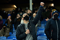 Football - 2020 / 2021 League Cup - Quarter-Final - Everton vs Manchester United - Goodison Park<br /> <br /> An Everton fan punches the air at the start of the match<br /> <br /> <br /> COLORSPORT/TERRY DONNELLY