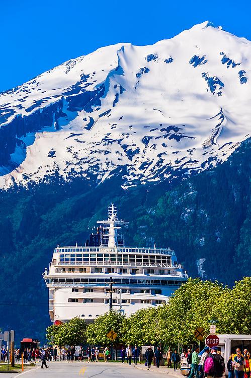 Norwegian Sun cruise ship docked in background, Historic District of Skagway, Alaska USA.