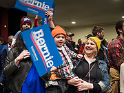 02 MARCH 2020 - ST. PAUL, MINNESOTA: LELA WRIGHT, center right holds her son, OLIVER LANDSVERK, 2 ½ years old, at a Bernie Sanders Get Out the Vote rally in the RiverCentre in St. Paul. More than 8,400 people attended the rally. Minnesota is a Super Tuesday state this year and Minnesotans will go to the polls Tuesday. Minnesota Sen. Amy Klobuchar was expected to win her home state, but she dropped out early Monday, March 2.        PHOTO BY JACK KURTZ