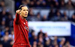 Liverpool's Virgil van Dijk gives instructions to his team-mates