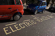 Power cables plug into the place of a petrol cap while recharging G-Wiz cars in central London. A power cable plugs into the place of a petrol cap while recharging a G-Wiz AEV (Automatic Electric Vehicle) car. The car is parked at the kerbside in Dover Street and is hooked up to a recharging point. The AEV has a range of up to 48 miles per charge with a certified top speed of 50 mph. A charging station, also called an electric recharging point and EVSE (Electric Vehicle Supply Equipment) supplies electricity for the recharging of electric vehicles (including plug-in hybrids). Although most electric cars can be recharged from a domestic wall socket, many support faster charging at higher voltages and currents that require dedicated equipment with a specialized connector..