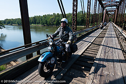 Chris Tribbey riding his 1947 Harley-Davidson WL Flathead across the more than 100-year old wooden Wabash-Cannonball Bridge on the Illinois and Indiana border during the Cross Country Chase motorcycle endurance run from Sault Sainte Marie, MI to Key West, FL (for vintage bikes from 1930-1948) As bikes crossed the wooden Wabash Cannonball railroad bridge built in 1897, it was pretty as can be but the warped boards that formed the narrow tracks made great bar stories for the rest of the trip. This was part of the 315 mile stage 4 ride from Urbana, IL to Bowling Green, KY USA. Monday, September 9, 2019. Photography ©2019 Michael Lichter.