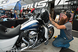 Mechanics do installs at the Kuryakyn display at  Destination Daytona Harley-Davidson during the 2015 Biketoberfest Rally. FL, USA. October 17, 2015.  Photography ©2015 Michael Lichter.