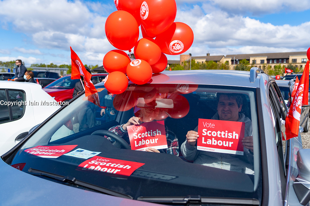 Glasgow, Scotland, UK. 5 May 2021. Scottish Labour Leader Anas Sarwar and former Prime Minister Gordon Brown appear at an eve of polls drive-in campaign rally in Glasgow today.  Labour supporters listen to speeches in their car. Iain Masterton/Alamy Live News