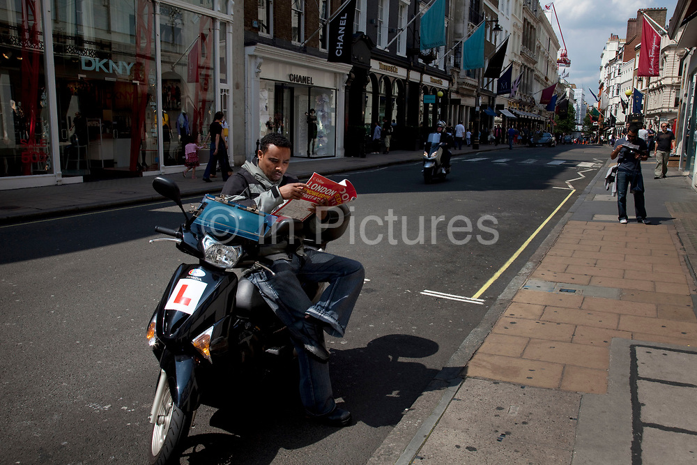 Bond Street Courier reading a map, central London