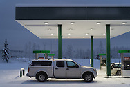 A Nissan Frontier rests at a gas station in Fairbanks to refuel on a winter day