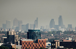 © Licensed to London News Pictures. 24/08/2016. London, UK. London skyline is seen through a haze of pollution from the north west. London is experiencing a second day of high temperatures with a peak of 30 degrees expected. Photo credit: Peter Macdiarmid/LNP