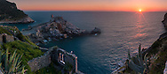 A gorgeous sunset in Portovenere. Portovenere is a small medieval town of the Italian Riviera in Liguria, Italy, not far from the border with Tuscany. I took this picture from the medieval castle of Portovenere on an evening at the beginning of April. This is stiched from 8 vertical frames.