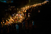 CHARLOTTESVILLE, USA - August 11: Neo Nazis, Alt-Right, and White Supremacists march through the University of Virginia Campus with torches in Charlottesville, Va., USA on August 11, 2017.