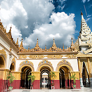 Mahamuni Buddha Temple (also known as Mahamuni Pagoda) is a highly revered religious site in Mandalay. At its heart is the Mahamuni Buddha image, reputed to be one of only five original likenesses of the Buddha made during his lifetime. It is covered in gold foil donated as tributes by worshippers and pilgrims.