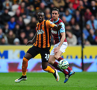 Hull City's Dame N'Doye vies for possession with Burnley's Michael Duff<br /> <br /> Photographer: Chris Vaughan/CameraSport<br /> <br /> Football - Barclays Premiership - Hull City v Burnley - Saturday 9th May 2015 - Kingston Communications Stadium - Hull<br /> <br /> © CameraSport - 43 Linden Ave. Countesthorpe. Leicester. England. LE8 5PG - Tel: +44 (0) 116 277 4147 - admin@camerasport.com - www.camerasport.com