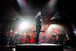 © Licensed to London News Pictures . 01/07/2017 . Manchester , UK . Conductor Tim Crooks . Hacienda Classical play at the Castlefield Bowl as part of Sounds of the City , during the Manchester International Festival . A collaboration between DJs Mike Pickering and Graeme Park and the Manchester Camerata orchestra , Hacienda Classical reworks music by bands including the Happy Mondays and New Order and features Manchester musicians including Rowetta and Peter Hook . Photo credit : Joel Goodman/LNP