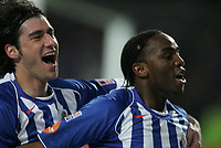 """PORTUGAL - PORTO 28 FEBRUARY 2005: GiourkasSEITARIDIS #22(L) and Benedict MACCARTHY #77(R) celebrating the goal scored by Benedict MACCARTHY #77, in the 23 leg of the Portuguese soccer league """"Super Liga"""" FC Porto (1) vs SL Benfica (1), held in """"Dragao"""" stadium  28/02/2005  21:13:24<br />(PHOTO BY: NUNO ALEGRIA/AFCD)<br /><br />PORTUGAL OUT, PARTNER COUNTRY ONLY, ARCHIVE OUT, EDITORIAL USE ONLY, CREDIT LINE IS MANDATORY AFCD-PHOTO AGENCY 2004 © ALL RIGHTS RESERVED"""