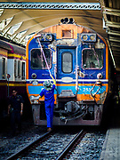 11 APRIL 2018 - BANGKOK, THAILAND:  Workers wash a train at Hua Lamphong train station in Bangkok. Songkran is the traditional Thai New Year and is one of the busiest travel periods of the year as Thais leave the capital and go back to their home provinces or resorts in tourist areas.      PHOTO BY JACK KURTZ