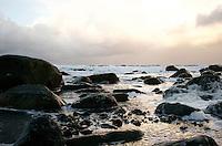 Alnes 20070116. Store bølger har laget mye skum i fjøresteinene ved Alnes fyr i Giske kommune under stormen en vinterdag i januar 2007. Alnes er også et populært sted for surfing.<br /> <br /> Large waves has generated a lot of foam on the rocks along the coastline next to Alnes lighthouse in Giske during a storm in january 2007. Alnes is also a popular place for surfing.<br /> <br /> Foto: Svein Ove Ekornesvåg